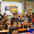 A classroom full of students excited for supplies