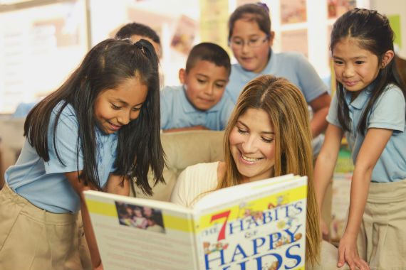 Teacher reads with her students