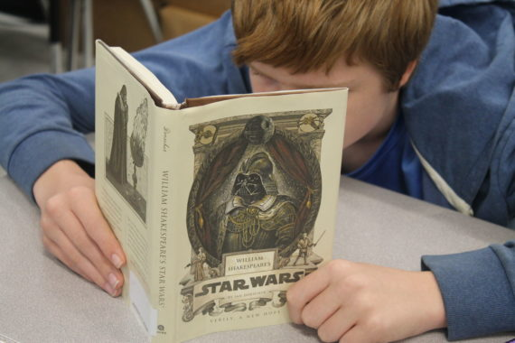 Student Reading Star Wars Book