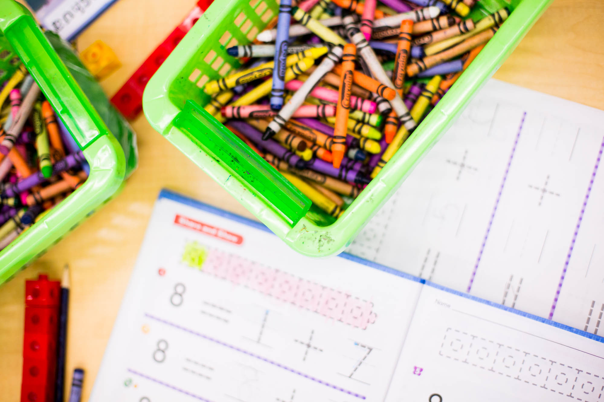 Box of crayons and math notebooks